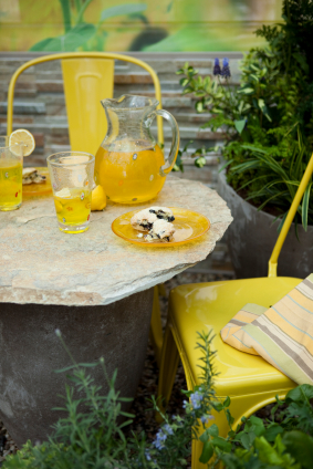 Fresh lemonade and blueberry scones on a patio table