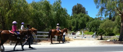 Kids headed to horseback riding lessons in Palos Verdes